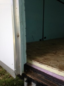 The trailer already had blue foam insulation on the walls and doors.  Dad added extra insulation to the floor so that the sinking cold air won't leak out of the bottom of the trailer.