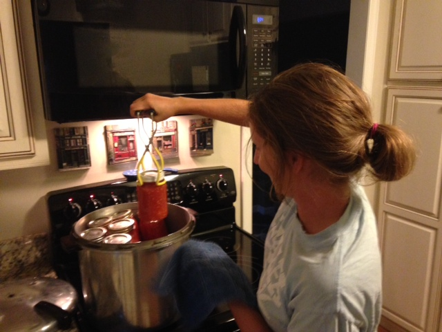 ​Pulling finished jars of tomato out of my great grandma's pressure cooker from 1961.